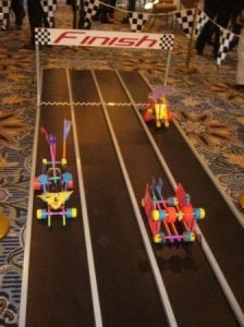 team build cars on racetrack